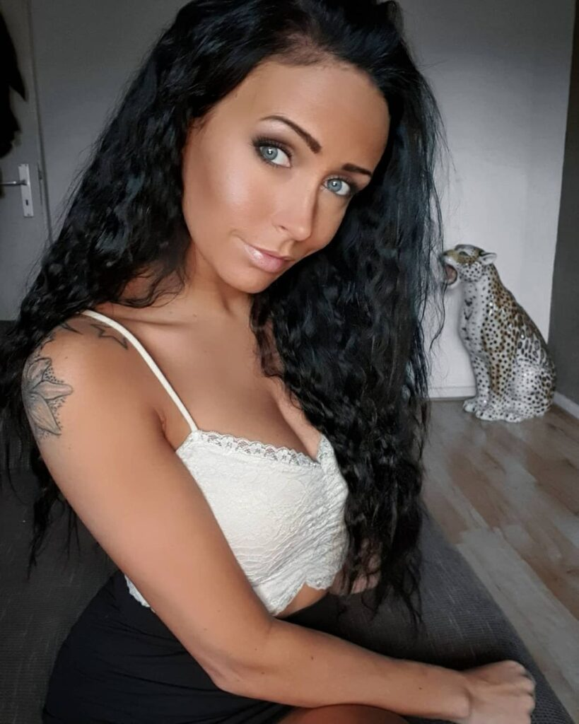 Curly Hairstyle For Black Hair Blue Eyes